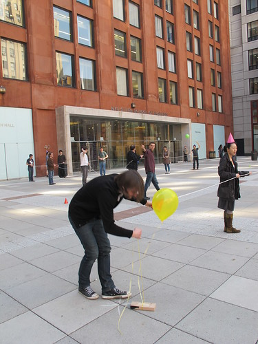Picking up a balloon