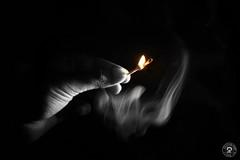 (mouli..) Tags: light white black colors canon dark fire rebel hands exposure dof smoke poi depth matchstick xsi