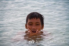 A Filipino boy from Pamilacan poses beside the beach (tommyschultz) Tags: 2005 people asia southeastasia philippines bohol visayas photooftheday pamilacan