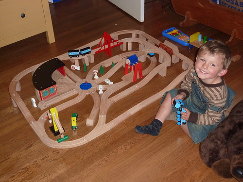 Robin with wooden trains