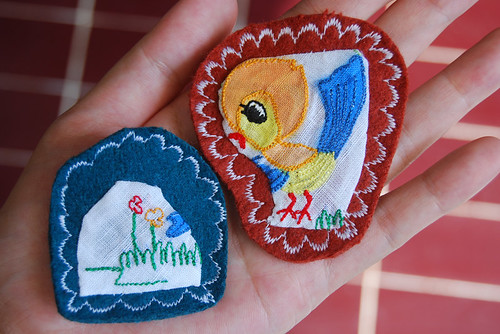 bird on a mountain brooches