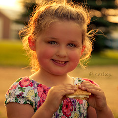 Smore Smile (Rebecca812) Tags: light sunset portrait sun sunlight tree cute girl beautiful smile barn children outside kid eyes soft pretty child eyelashes sweet daughter naturallight lips niece ponytail backlit pigtails smore canon5dmarkii