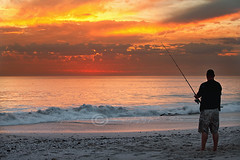 Eternal flame! (Jo-Ann Stokes) Tags: sunset fire fishing fisherman fiery fishingrod aflame seafishing melkbosstrand alonefisherman beachmseascape