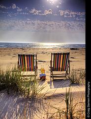 Ah.... (Craig - S) Tags: blue sunset shadow summer vacation sky sun white beach water beer clouds sand chair waves shadows weekend getaway relaxing restful peaceful lakemichigan canvas corona sling serene rays cooler relaxation tranquil beachchairs beachgrass dunegrass beachchair ludingtonmichigan takiniteasy