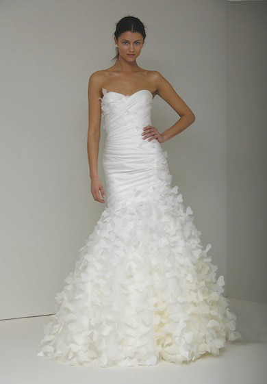 Strapless style wedding dress decorated with flowers along the dress