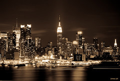 New York City (The Empire State) (a2roland) Tags: a2rolandyahoocom norman zeb a2roland flickr photo pic scene nyc new york city night lights reflection color sepia monotone mono tone buildings empire state red haze water river hudson streaks yellow blue orange glow metropolis metropolitan © photography all rights reserved