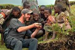 Frank showing some children how they look in Digital (Pat The Plant) Tags: africa light smile look digital children frank funny child outdoor picture some they how uganda showing amaze kimpala