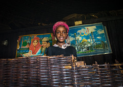 Gurage girl inside her traditional house decorated with muslim posters on the walls, Gurage Zone, Butajira, Ethiopia (Eric Lafforgue) Tags: abyssinia africa architecture art bamboo butajira candid child children copyspace culture decorated decoration depiction developingcountry eastafrica ethiopia ethiopia0617439 ethnic gurage homeinterior horizontal hornofafrica house hut indigenousculture indoors islam muslim onegirlonly oneperson portrait poverty realpeople religion religious ruralscene smiling toukoul traditional tukul
