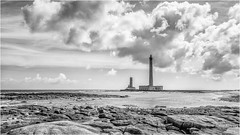 Lighthouses blow no horns, the only shine (Peter Jaspers (on/off)) Tags: frompeterj© 2017 olympus zuiko omd em10 1240mm28 169 bw bn blackwhite zwartwit france french seascape seaside lighthouse phare semaphore manche cotentin clouds sky nuage view gatteville pointedebarfleur valdesaire normandie normandy blancnoir