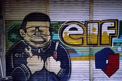 Taichung_20091115_01 (Lordcolus) Tags: color film wall graffiti minolta snapshot taiwan slide signage taichung 台灣 台中 cle e100g minoltadimagescanelite5400 模範社區 procamera 模範街 kokda rolleisonnar4028hft 攝團