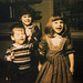 Linda Lane aged 4, Lisa aged 3, and Ward age 2 - the Lane kids,  at our house on the corner of 3rd and L street in downtown Anchorage, Alaska, in the year 1959/1960