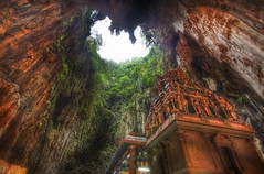 The Temple Deep in the Caves (Stuck in Customs) Tags: world travel mountains west color digital religious temple photography blog high ancient nikon shrine asia dynamic stuck south hill deep east caves sri malaysia sacred limestone imaging cave kuala kualalumpur southeast spiritual hindu range kl cavern gombak malai tamil hdr sanctuary batu hollow trey batucaves thaipusam lumpur travelblog customs selangor murugan sungai mayuri ratcliff subrahmanya d2xs stuckincustoms kandasamy  kwllmp  subramaniar klmp