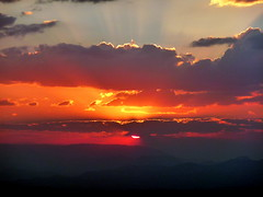 African Sunset (Alan1954) Tags: light sunset red orange cloud holiday rays ethiopia 2009 lalibela flickrsbest