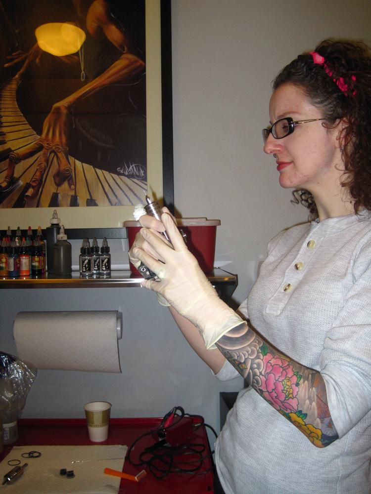 Tattoo - Katie preps her gun