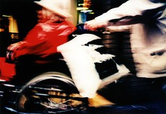 Differently dynamic (ale2000) Tags: street red people woman blur amsterdam geotagged donna blurry xpro kodak crossprocess candid cosina wheelchair fast photowalk rosso cx2 mossa veloce sfuocata epr fuorifuoco aledigangicom geo:lat=52371963 geo:lon=4892038