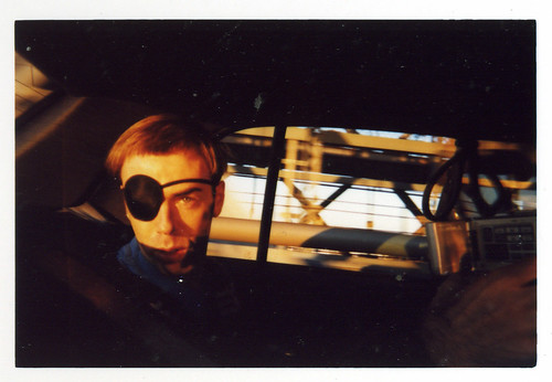 Momus in a car