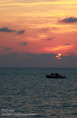 Dark boat with sunset (Pkamo@Tai) Tags: trip travel asian thailand asia tour thai rayong 2010  puykamo