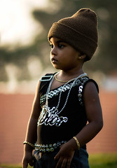 Innocence is BLING! (Vividplus) Tags: sun girl gold evening kid child sony style kerala jeans cap bangle hip bling dslr a200 stylish technopark woolencap techabreak sonyalpha sonyalphaa200 sonyalphadslra200
