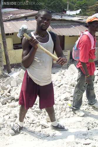 Volunteer demolisher with sledgehammer