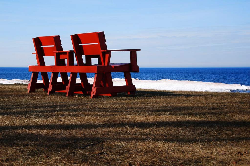 Red wooden seats overlooking Lake Superior.