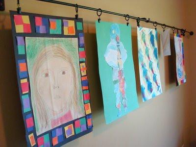 Kids-Art-Displayed-on-a-Curtain-Rod