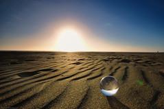 Spheres (-Nicole-) Tags: camera sunset newzealand sun reflection sand auckland nz sanddunes lenses crystalball togetheralone karekarebeach sigma1020mmf4056 nikond90 acrylicball gear