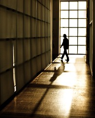 walk the line (Andy Kennelly) Tags: california light window silhouette museum sepia architecture walking hall los shadows angeles geometry walk line getty fleeting