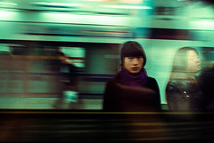 From Metro, Girl Looks at Me (wndlss) Tags: china city girl train day shanghai platform metropolis lonely panning windlass apsc fujifinepixs2pro nikkor28mmf28ai wndlss schuylerthornekelly stkelly
