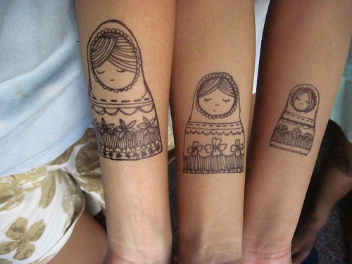 Connecting Tattoos For Sisters. a shared Tattoo between