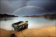 Rainbow and a wee boat - Ardtoe - Scotland (angus clyne) Tags: morning blue light red sea orange white lake seascape storm black reflection green art beach water yellow dar