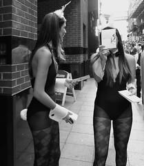 Camera Shy (Ian Brumpton) Tags: street england urban blackandwhite bw bunny london blancoynegro blackwhite candid models streetphotography monochromatic londres angleterre biancoenero camerashy easterbunnies promogirls modelbehaviour londonstreetphotography blackwhiteheartbeats