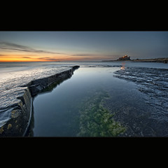 Pointing @ the Castle (Reed Ingram Weir) Tags: longexposure sea sky seascape seaweed castle sunrise landscape rocks smooth northumberland land ash coastline fx bamburgh volcanic iconic diyfilterholder reeingramweir leexprofilters warmcolourdeepblue