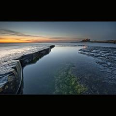 Pointing @ the Castle (Reed Ingram Weir) Tags: longexposure sea sky seascape seaweed castle sunrise landscape rocks smooth northumberland land ash coastline fx bamburgh volcanic iconic diyfilterholder reeingramweir leexprofilters warmcolourdeepblue