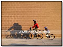Tandem (Lisa-S) Tags: boy shadow portrait woman selfportrait ontario canada brick me bicycle wall kids lisas mother lisa owen tandem allrightsreserved brampton invited may10 6703 platinumheartaward soldongetty getty2010 copyrightlisastokes gappool getty20100513