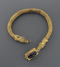 A Sarmatian Gold Choker with Mythical Beast Inlaid with Turquoise and a Large Amethyst Cabochon