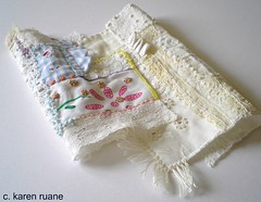 crazy patchwork (contemporary embroidery) Tags: lace silk fringe whiteonwhite picnik crazypatchwork ticking prairiepoints vintagecloth rouleauloops handpaintedcloth