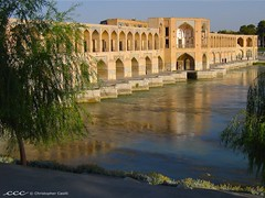 Iran /         (Les Yeux Heureux) Tags: travel bridge tree water beautiful leaves architecture canon river asia iran dam middleeast arches structure international flowing riverbank esfahan isfahan weir s500 irn zayandeh neareast   iro khaju        lesyeuxheureux christophercasilli