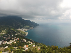 Stretching out to the sea (Jonathan-M) Tags: blue houses light italy white man building green water rain rock clouds buildings dark bay coast pretty south leafs amalfi veiw southitaly