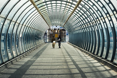 Strolling (Sean Batten) Tags: london england unitedkingdom gb poplar vanishingpoint nikon df 58mm people candid streetphotography street bridge tunnel eastlondon docklands dlr city urban light shadow