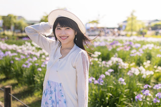 Portrait of happy young woman in Japanese iris field