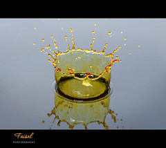 Golden Crown.. II (Faisal | Photography) Tags: water speed photography gold high drop explore splash frontpage canonef100mmf28macro canoneos50d dropcrown canonspeedlitetransmitterste2 canonspeedlite580exii faisal|photography