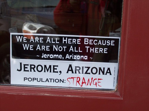 Sign in shop window - the mental state of Jerome