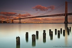 Bay Bridge - San Francisco, California, USA (Rich Capture) Tags: sanfrancisco california bridge sunset sky seascape water clouds america reflections landscape oakland coast unitedstates shore richard baybridge bayarea coastline pilings westcoast wonderfullight richardmatyskiewicz matyskiewicz treasureinland