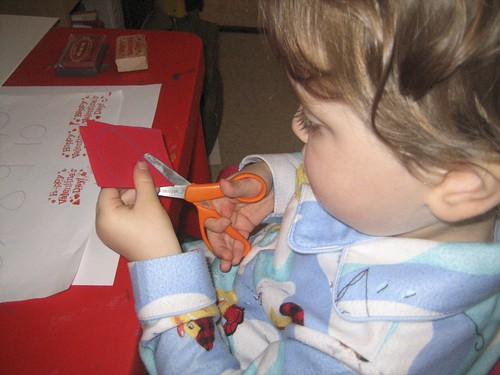 Dylan cutting out hearts to make valentines
