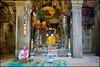 Peace at his feet (Souvik_Prometure) Tags: angkorwat explore siemreap phnombakheng frontpage taphrom preahkhan banteaysrey banteaysrei banteaykdei sigma1020mm bayontemple nikond90 souvikbhattacharya