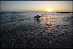 Surfer and sunset, Waikiki beach (rickz) Tags: ocean sunset beach water night hawaii evening surf pacific waikiki oahu dusk surfer tide honolulu waikikibeach settingsun waikikisunset