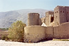 Rustaq fort, Oman (annkelliott) Tags: travel mountains horizontal village desert image fort towers middleeast scan oasis oman imposing sultanateofoman feelsgood takenin1977 annkelliott scanfromoldprint rustaqfort rostaqfort nowrenovated