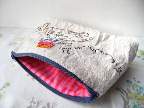 'off to see the world' pouch