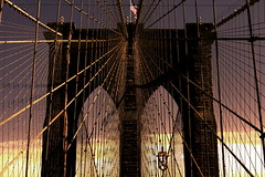 Brooklyn bridge at sunset. (Maurizio Contini) Tags: ocean park street new york city nyc travel bridge windows light vacation sky people panorama horse woman usa holiday ny storm reflection building window water car statue skyline architecture brooklyn clouds america skyscraper river garden dark square liberty island pier us iron artist pattern state geometry walk alice manhattan united north central broadway dramatic police nypd atlantic east madison empire hudson states mm crosswalk avenue wonderland 5th flatiron nord fifth maurizio rockfeller contini