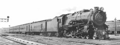 Pennsylvania Railroad K 4 class Pacific steam locomotive on a passenger train passing through Englewood Station. Chicago Illinois circa 1930's.